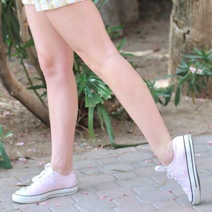 worn-pink-converse-shoes