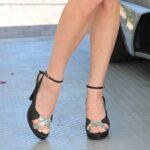 worn-black-high-heels